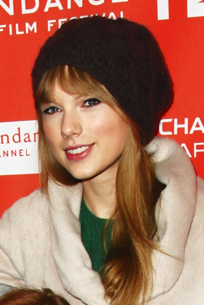 The singer kept it casual with her loose straight hair that's covered in a black beanie at the premiere of