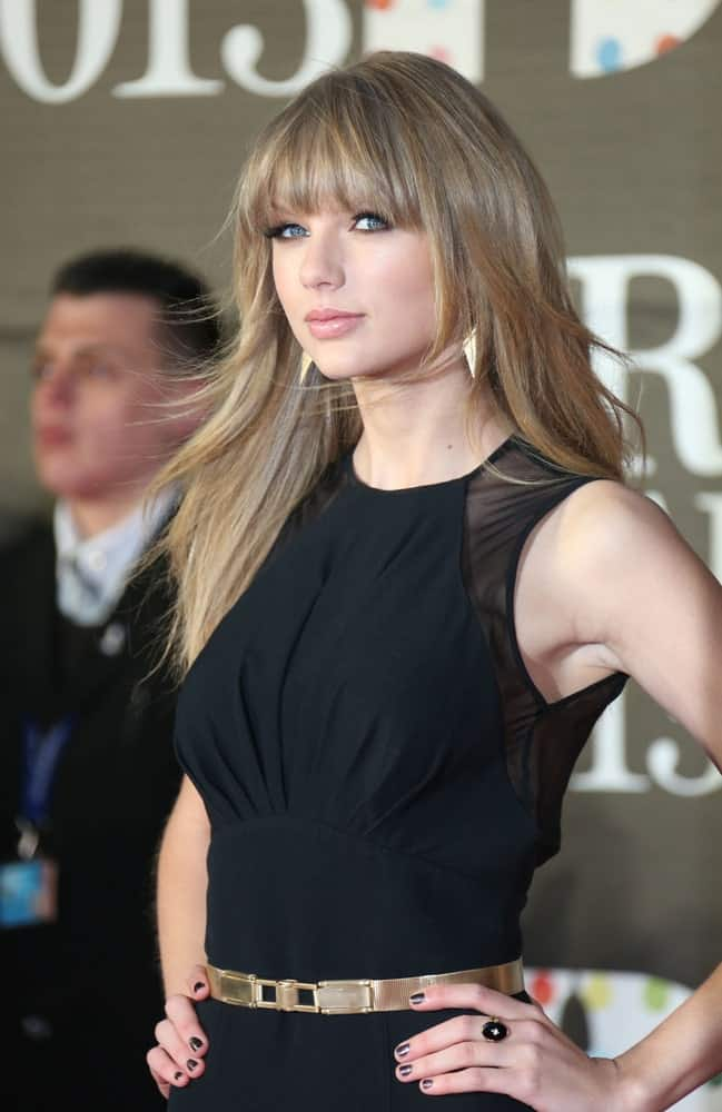 Taylor Swift arrived for the Brit Awards 2013 at the O2 Arena, Greenwich, London on Feb 20th with a long layered hairstyle incorporated with eye skimming bangs.