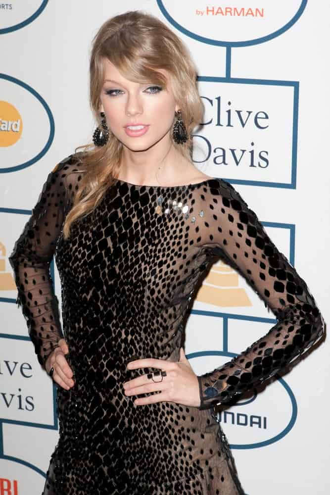The singer rocked a trendy half updo with long side bangs during the Clive Davis and The Recording Academy annual Pre-GRAMMY Gala on January 25, 2014.