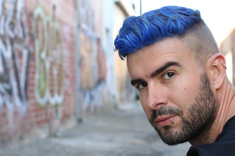 Man with dyed hair and undercut style
