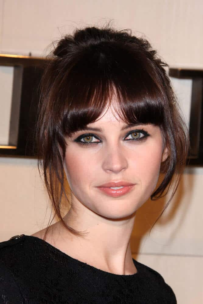 Curtain bangs is one of Felicity Jones's trademark looks and last October 2011, she incorporated this look with a messy updo for the Burberry Body Launch.