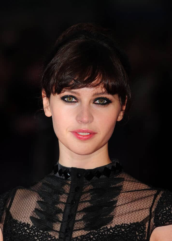 Felicity Jones went a little bit edgy with her dark eye make-up and an all-black getup at the screening of 'Like Crazy' last October 2011 . Her hair was styled in an updo with tossed bangs.