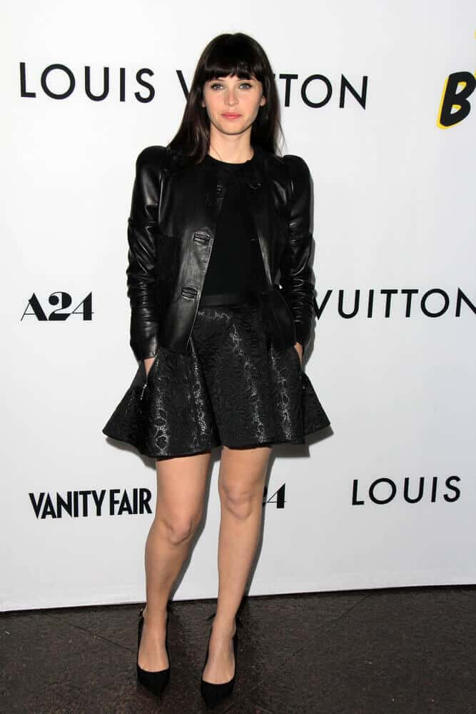 Felicity Jones kept it dark and edgy at the LA premiere of 'The Bling Ring' last June 2013. Her all-black outfit is paired with a medium-length cut with blunt bangs.