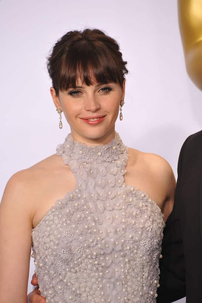 Felicity Jones in a Semi Messy Updo with Bangs.