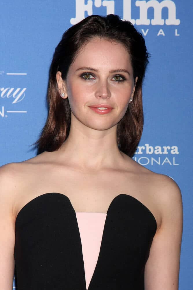 One way to exhibit a sophisticated-but-not-too-polished look is through the slicked back style. This look was worn by Felicity Jones during the  Santa Barbara International Film Festival held last January 29, 2015.