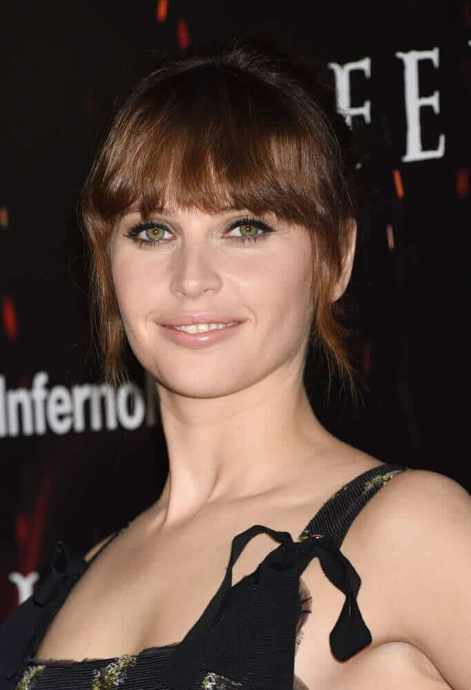 Felicity Jones with Blunt Bangs and Tendrils.