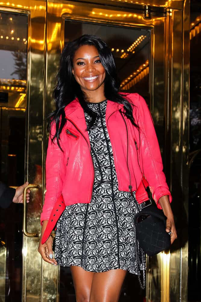 Gabrielle Union's long waves are freely flaunted last October 10, 2013 at the Uptown Hotel, New York City.