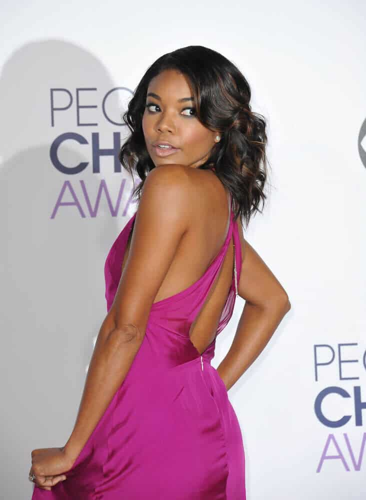 Gabrielle Union exhibiting her highlighted curls.