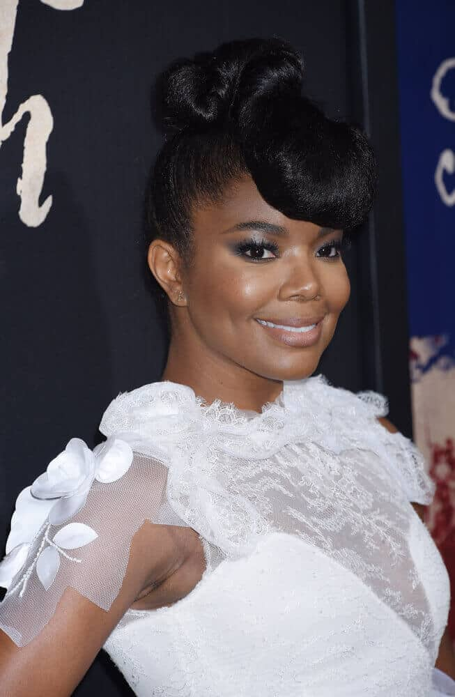 Gabrielle Union wearing a vintage upstyle with bouffant.