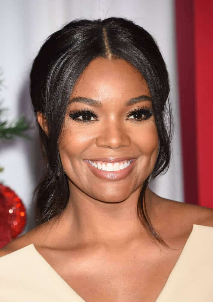 Gabrielle Union sporting a ponytail with wavy tendrils