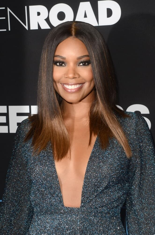 Gabrielle Union exhibiting a center-parted, sleek ombre hair.