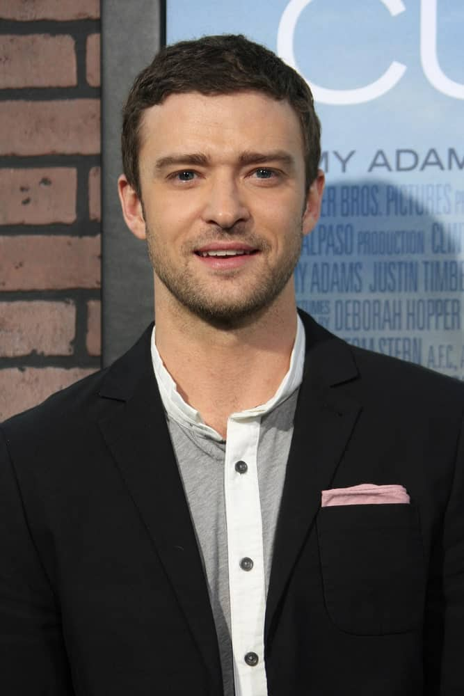 Mr. Timberlake wore his hair dark with a short wavy cut paired with a smart casual look to the premiere of 'Trouble With The Curve' last September 19, 2012.