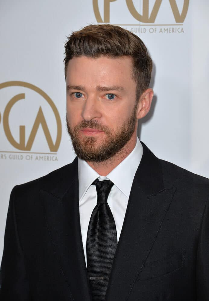Justin Timberlake attended the 2017 Producers Guild Awards in a sophisticated suit and tie, with his hair slightly brushed to one side in order to exhibit depth and dimension.