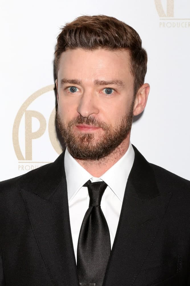 Justin Timberlake attended the 2017 Producers Guild Awards in a sophisticated suit and tie, with his hair slightly brushed to one side and a slightly trimmed beard.