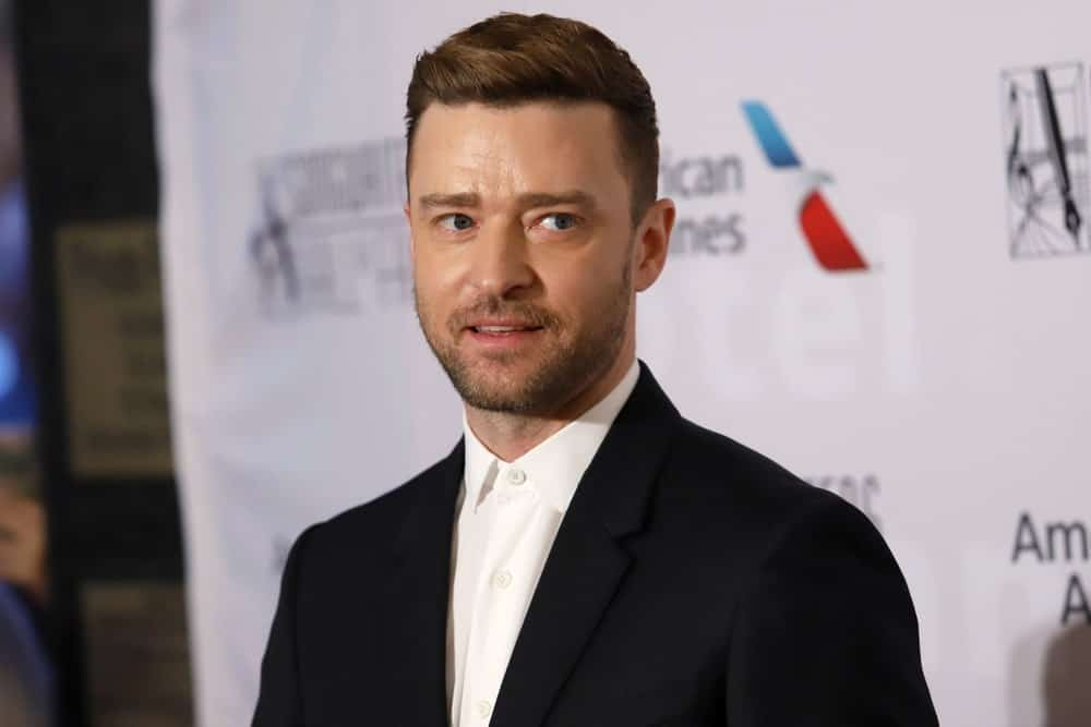 Justin Timberlake attends the Songwriters Hall of Fame at the Marriott Marquis on June 13, 2019, in New York City with a neat and classic short cut dark brown hair brushed slightly to the side.