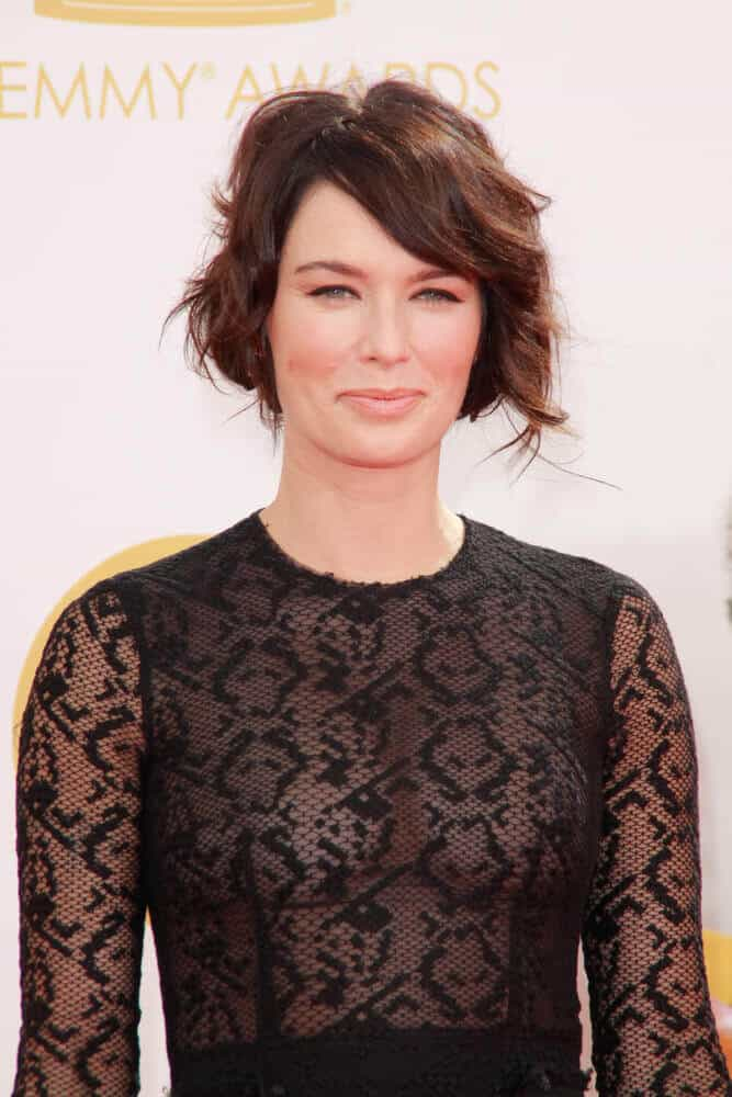 An incredibly stylish version of Lena Headey with tousled layers and side-swept bangs was seen at the 65th Primetime Emmy Awards held last September 2013.