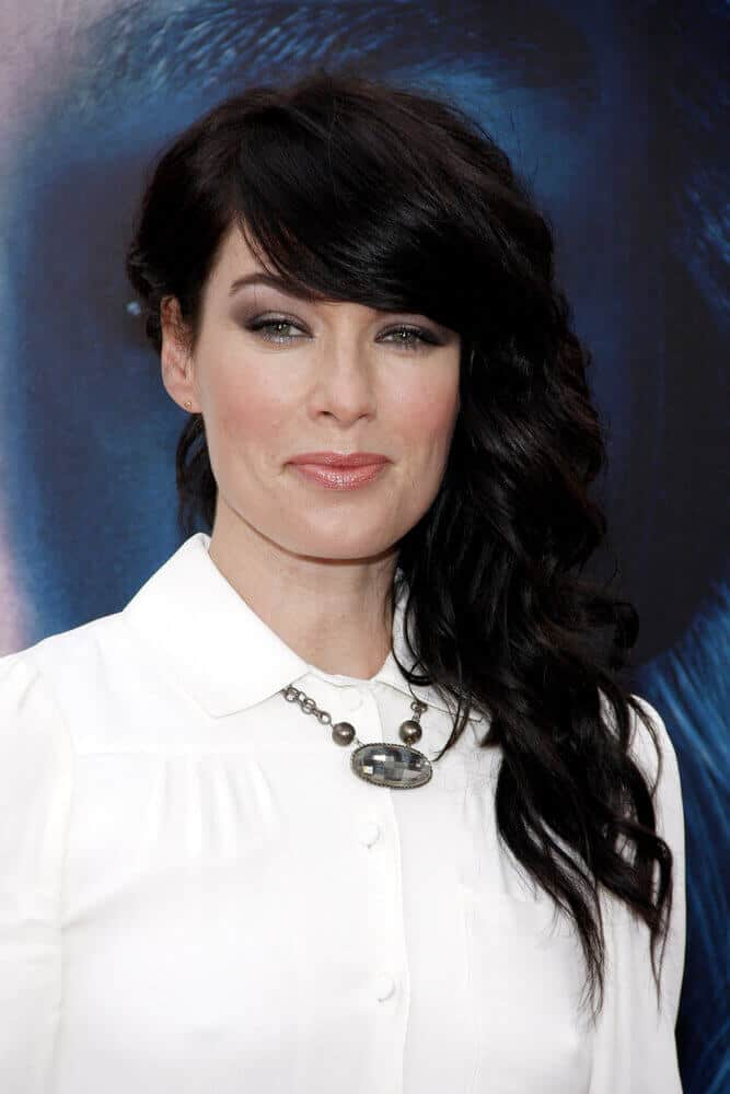 Lena Headey's side-swept curls are styled in an edgy way, with all the thick side bangs and volume. This look was worn last March 18, 2013 at the LA premiere of 'Game Of Thrones Season 3'.