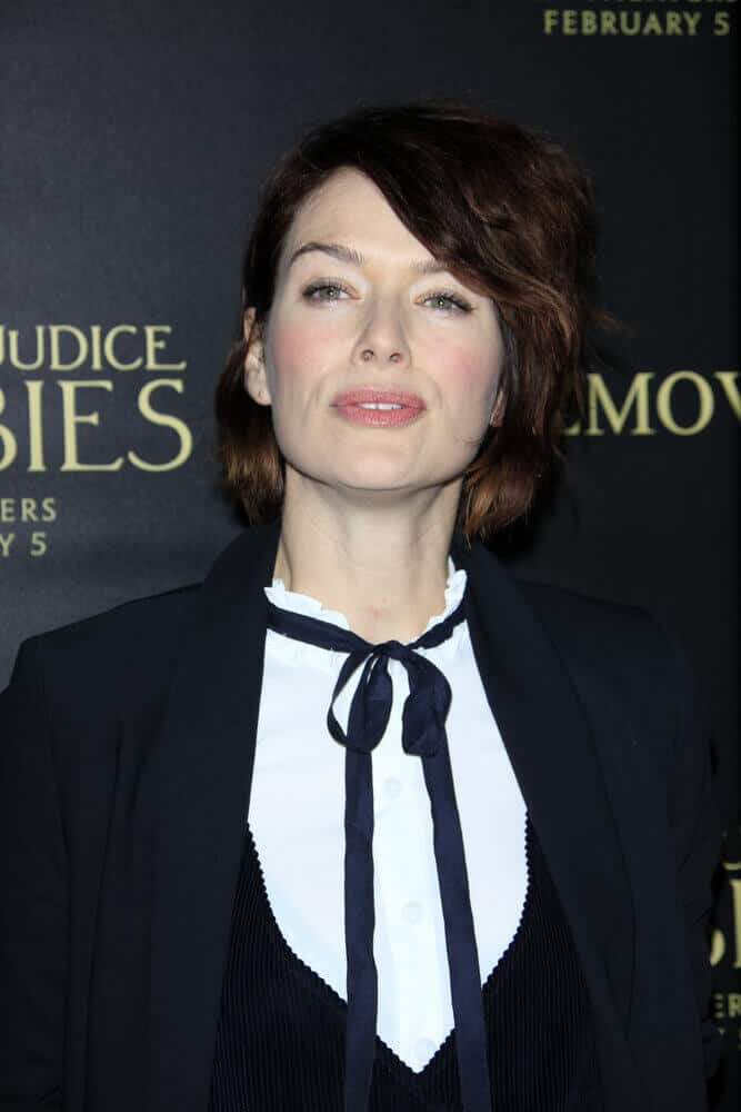 Lena Headey sporting side-swept, layered bangs and teased hairstyle