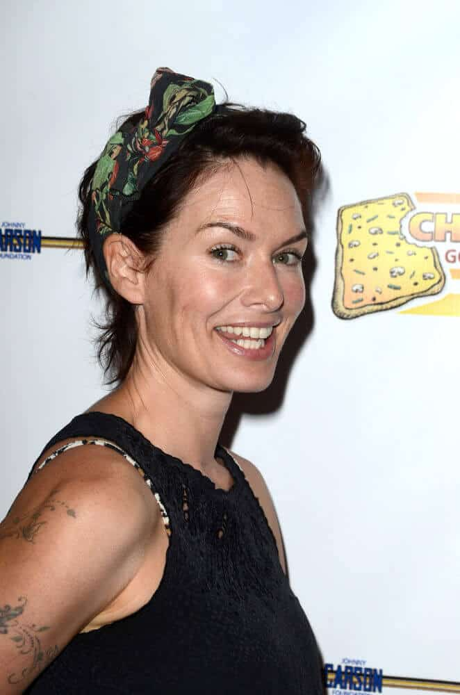 Lena Headey in a short hairstyle incorporated with a printed green bandana.