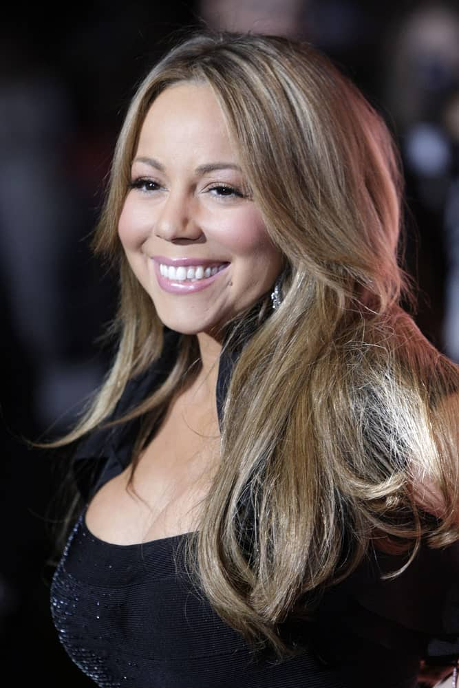 Mariah Carey looked gorgeous with this slightly messy hairstyle parted in the middle to pair with her black outfit at the 2010 Palm Springs International Film Festival.