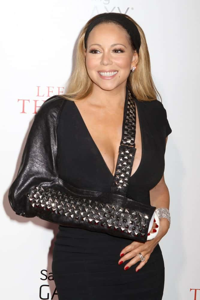 Mariah Carey is looking fresh and happy with her sleek and straight hair incorporated with a black headband that matches with her dress and black leather cast covering. This was taken last August 5, 2013 for the New York premiere of