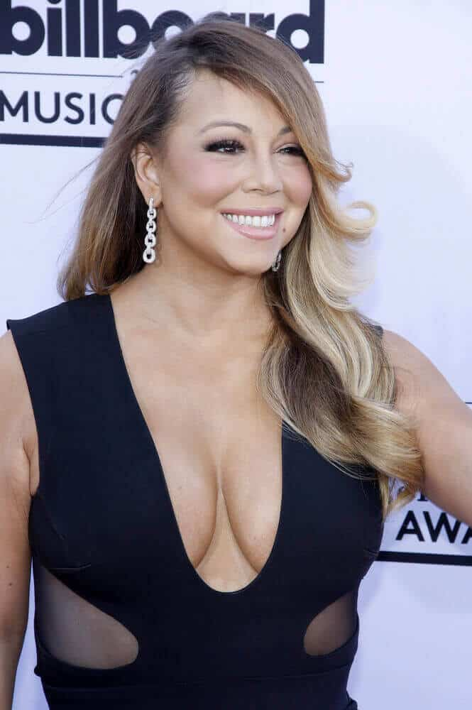 The singer had her hair styled with layers swept to only one side, leaving a decent and unique finish. This look was worn for the 2015 Billboard Music Awards.