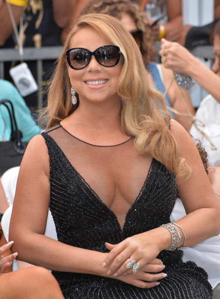 Mariah Carey in an elegant dress, with a pair of sunglasses and an effortless, loose hairstyle might not be the best thing to hear but believe it or not, she nailed this look. This was taken last August 5, 2015 at the Hollywood Boulevard where she was honored with a star on the Hollywood Walk of Fame.