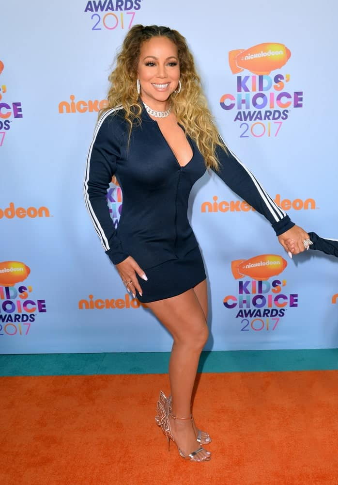 The singer showcased her quirky and youthful side with her thick and playful curls parted in the middle with cornrows when she attended the Nickelodeon 2017 Kids' Choice Awards.