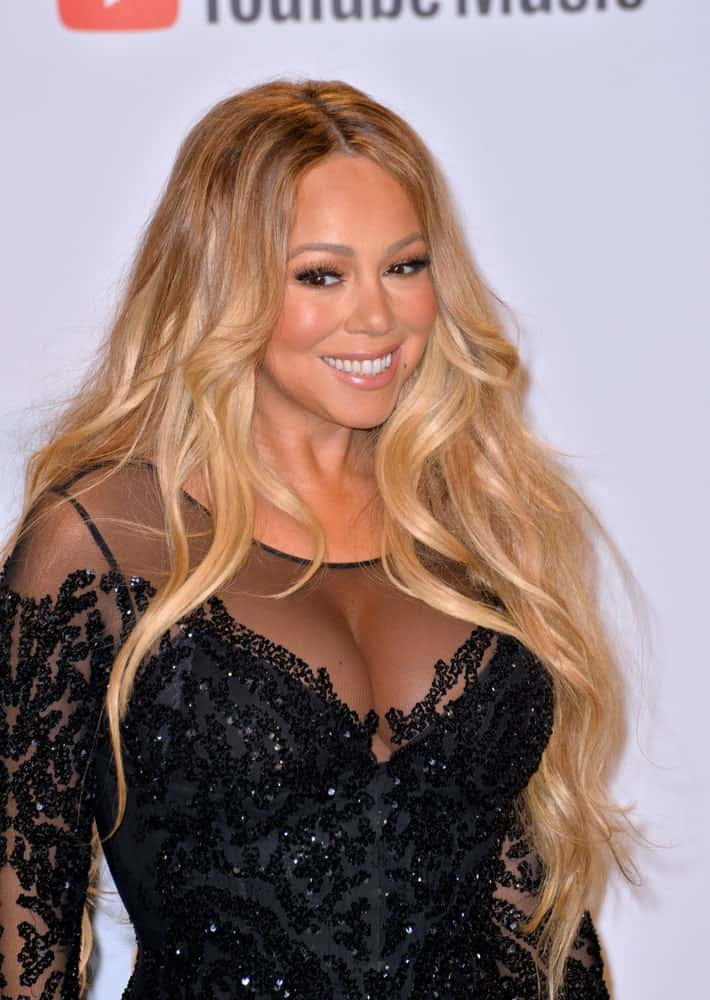 Mariah Carey attended the October 09, 2018 American Music Awards at the Microsoft Theatre LA Live sporting a hairstyle with light tone and waist-long to stand out against her black sequined dress.