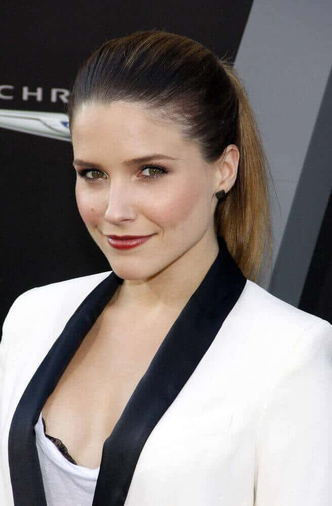 Sophia Bush looking prim and proper with a classic ponytail worn at the LA premiere of 'Total Recall' last  August 1, 2012.