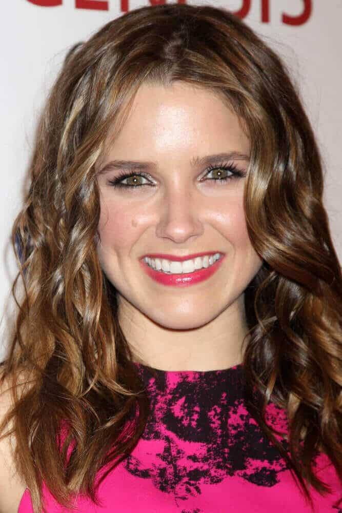 Sophia Bush with beachy waves is charming enough to slay the 2012 Genesis Awards held at the Beverly Hilton Hotel, Beverly Hills, CA.