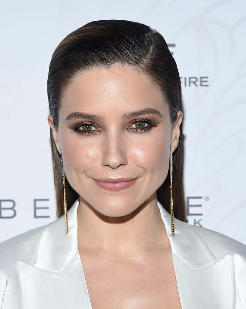 Sophia Bush in a slicked back hairstyle.