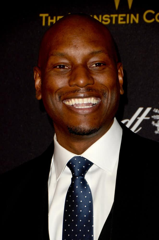 Tyrese Gibson looking all classy and formal with his shaved head and black suit worn at the Weinstein Company & Netflix 2016 Golden Globe After Party.