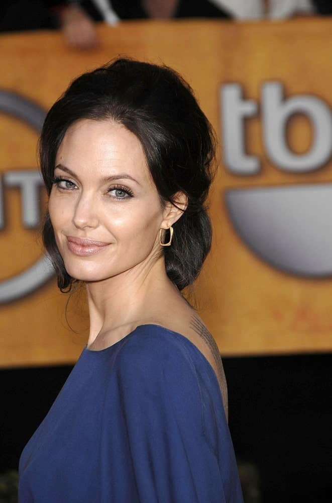 Angelina Jolie wore a simple yet elegant blue dress to match her messy and loose half-up hairstyle with a slight low bun look at the 15th Annual Screen Actors Guild SAG Awards in the Shrine Auditorium, Los Angeles, CA on January 25, 2009.