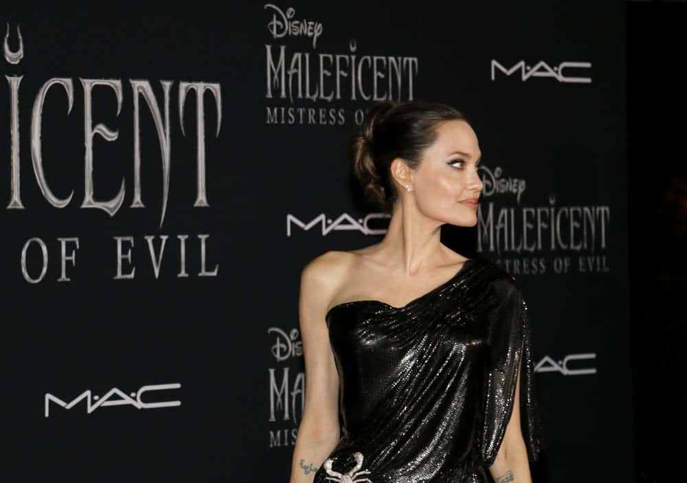 Angelina Jolie was at the World premiere of Disney's 'Maleficent: Mistress Of Evil' held at the El Capitan Theatre in Hollywood, USA on September 30, 2019. She wore a sexy black dress to match her slick bun hairstyle and smokey eyes.