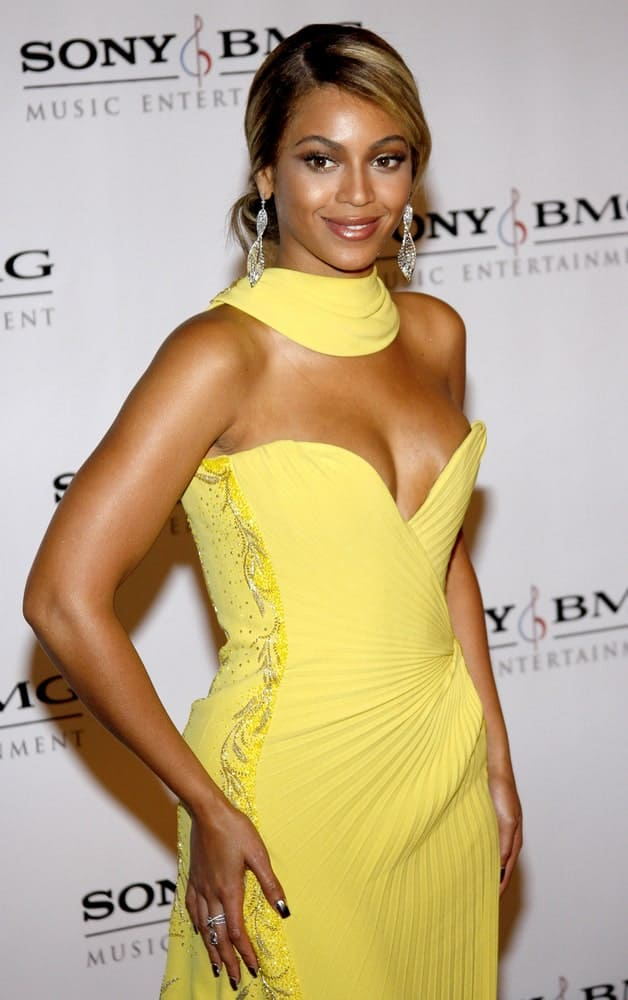Beyonce in a gorgeous yellow gown paired with her highlighted side part bun at the 2008 Sony/BMG Grammy After Party held at the Beverly Hills Hotel on February 10, 2008.
