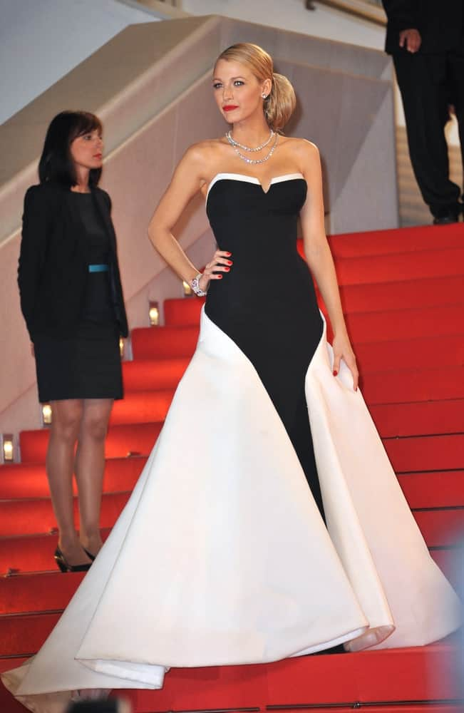 "Last May 16, 2014, Blake Lively swept up her long hair into this elegant low bun hairstyle that complemented her black and white gown at the gala premiere of ""Captives"" at the 67th Festival de Cannes."