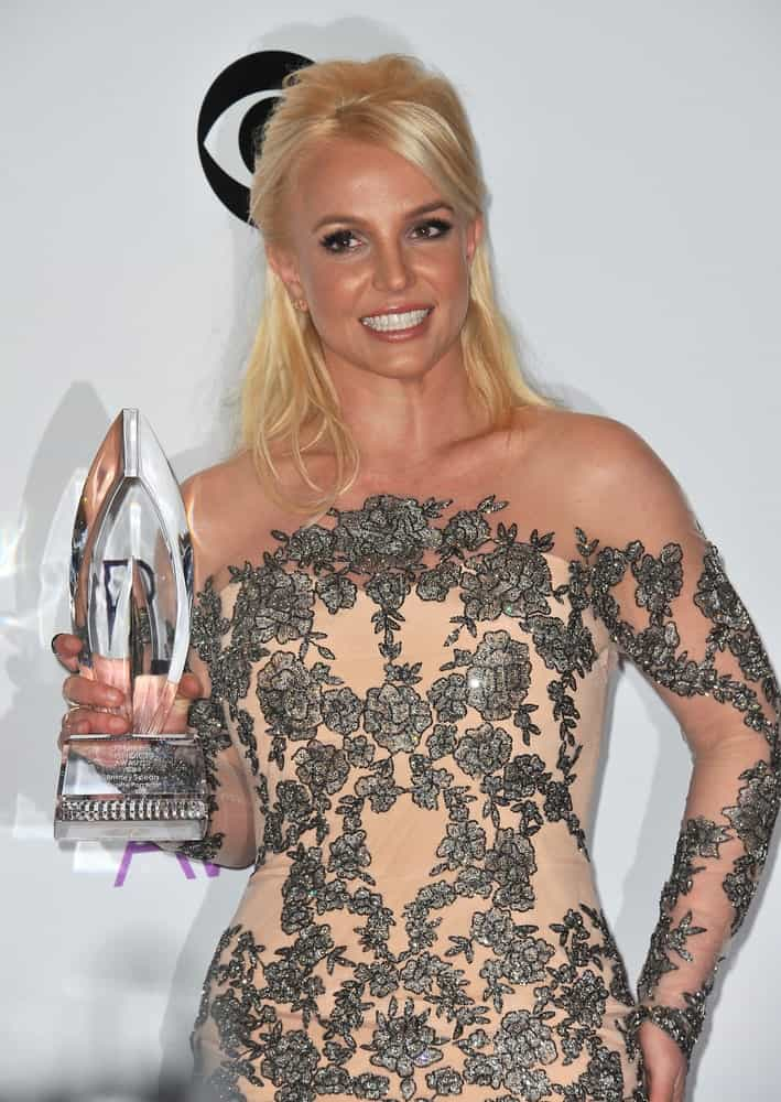Britney Spears looked gorgeous in a nude floral dress that matched perfectly with her messy blonde half updo. This was taken at the 2014 People's Choice Awards held on January 8th.