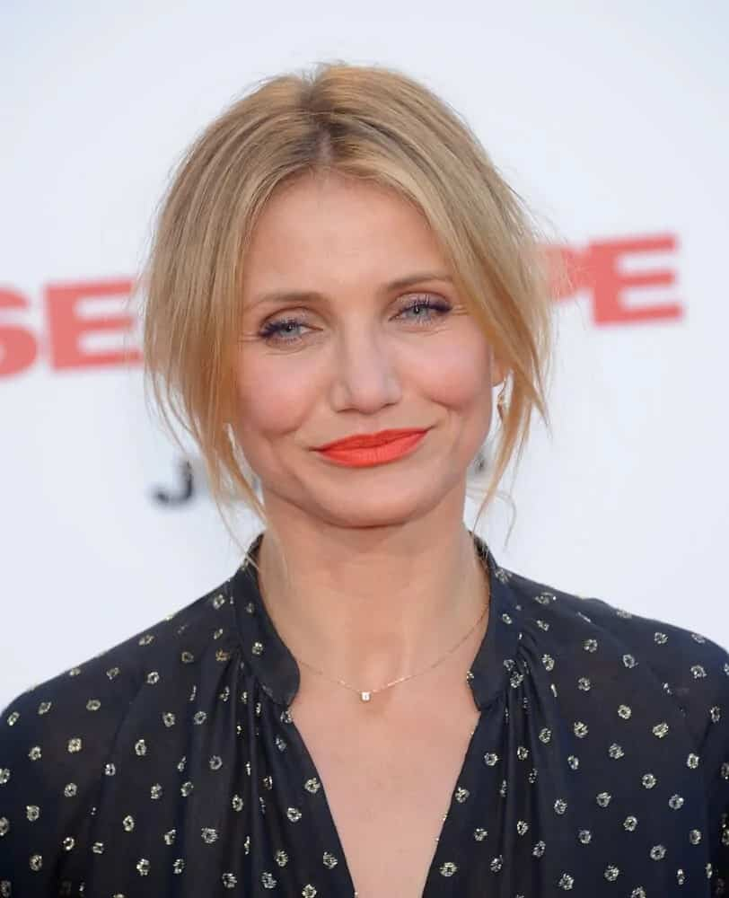 """Cameron Diaz was a picture of chic beauty wearing her half-up hairstyle with curtain bangs that looks great on her simple make-up. She wore this look during the world premiere of her movie """"Sex Tape"""" last July 10, 2014."""