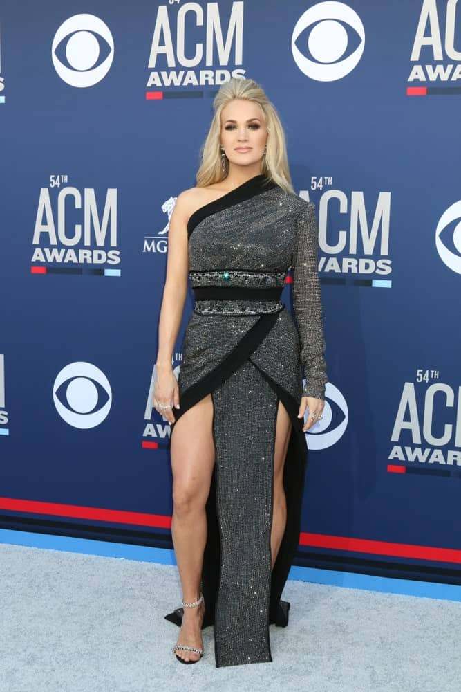 Carrie Underwood arrived at the 54th Academy of Country Music Awards in a half-up hairstyle on April 7, 2019, in Las Vegas, NV.