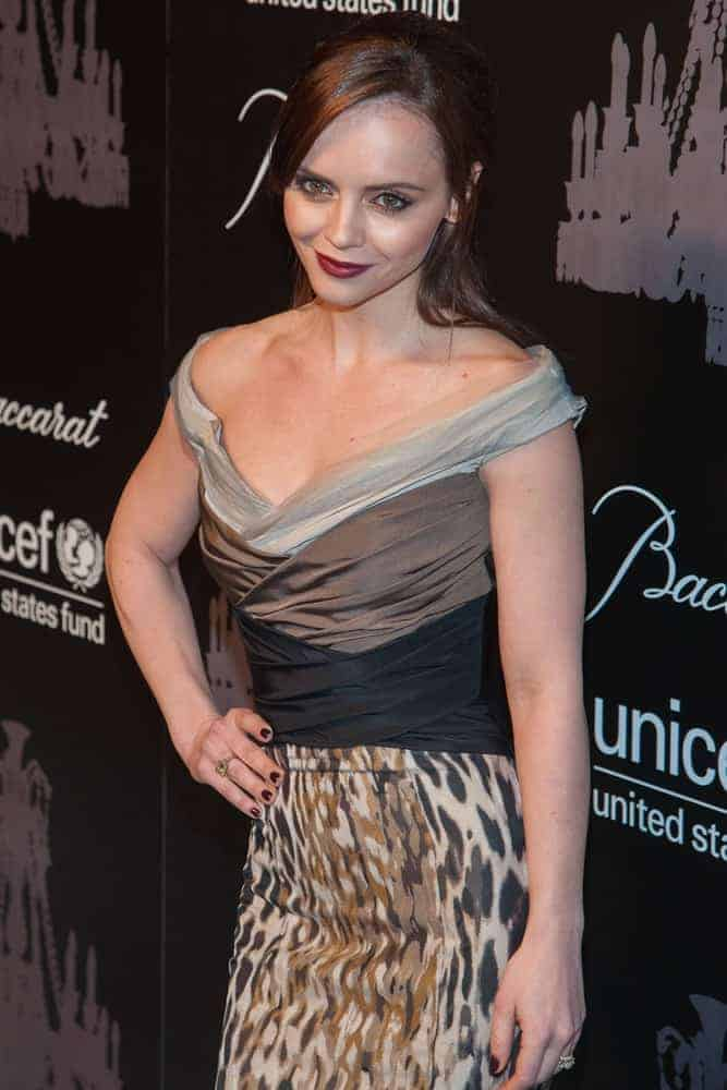 Actress Christina Ricci attended the 9th Annual UNICEF Snowflake Ball at Cipriani Wall Street on December 3, 2013, in New York City. She paired her elegant dress with a half-up brunette hairstyle incorporated with long side-swept bangs.