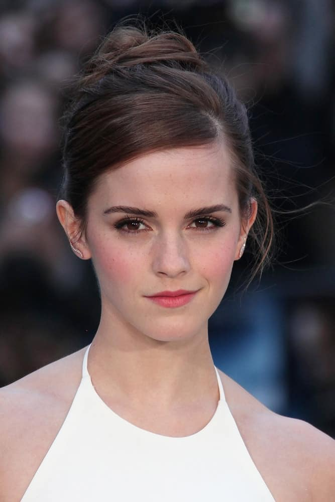 Emma Watson attended the UK premiere of 'Noah' at Odeon Leicester Square on March 31, 2014, in London, England. She was quite stunning in her white dress and messy high bun hairstyle that emphasizes her gorgeous neckline.