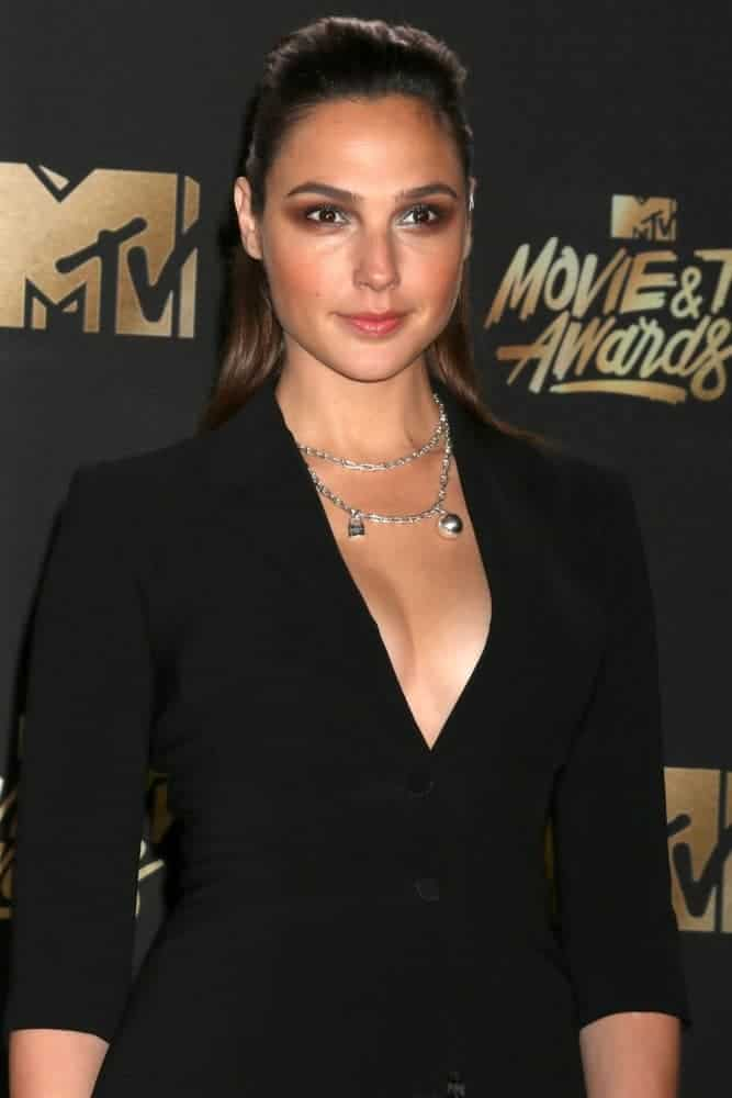 Gal Gadot attended the MTV Movie and Television Awards at the Shrine Auditorium on May 7, 2017, in Los Angeles, CA. She came with a stunning black outfit to pair with her slicked-back half-up straight hair with subtle highlights.