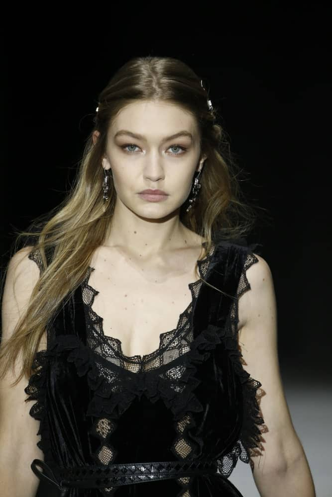 Gigi Hadid was quite lovely with her black dress and pinned half-up hairstyle when she walked the runway at Bottega Veneta Fall/Winter 2018 Collection at the American Stock Exchange on February 9, 2018, in New York City.
