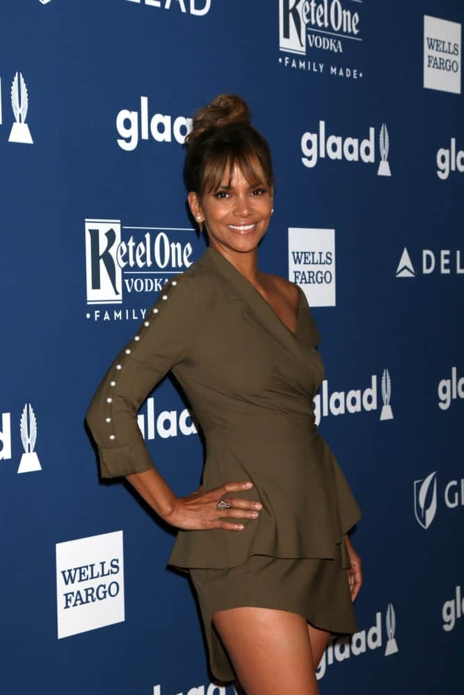 Halle Berry paired her stylish dark green smart casual outfit with a neat and slick top knot bun hairstyle with loose bangs at the GLAAD Media Awards Los Angeles at Beverly Hilton Hotel on April 12, 2018, in Beverly Hills, CA.
