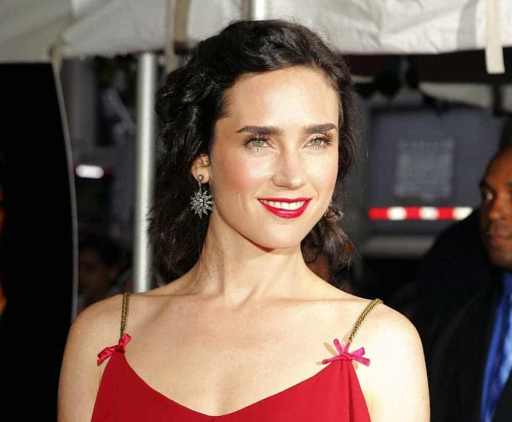 Jennifer Connelly wore a Viktor & Rolf dress at the Touchstone Pictures Dark Water Premiere at Clearview's Chelsea West Cinemas in New York, NY on June 27, 2005. She paired this with a curly and dark half-up hairstyle that has a slight tousle.