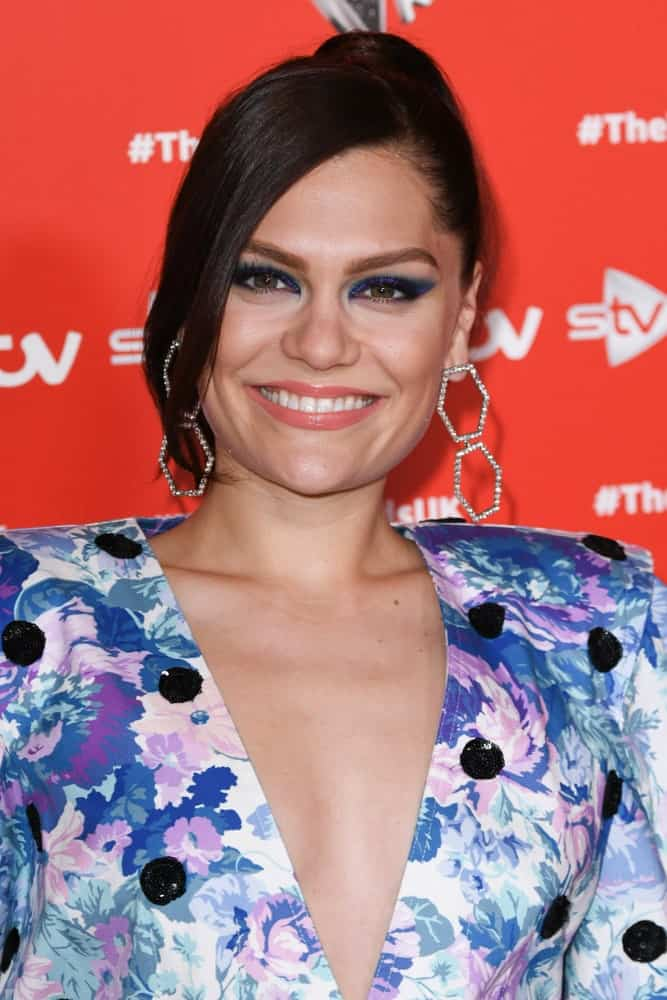In London last June 06, 2019, Jessie J was at The Voice Kids UK 2019 photocall wearing a colorful floral outfit paired with her elegant upstyle bun that has side-swept bangs.