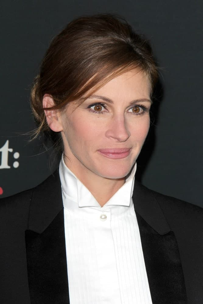 "Julia Roberts styled her brunette hair in a decent low bun with side-swept bangs during the ""August: Osage County"" LA Premiere at Regal 14 Theaters on Dec 16, 2013."
