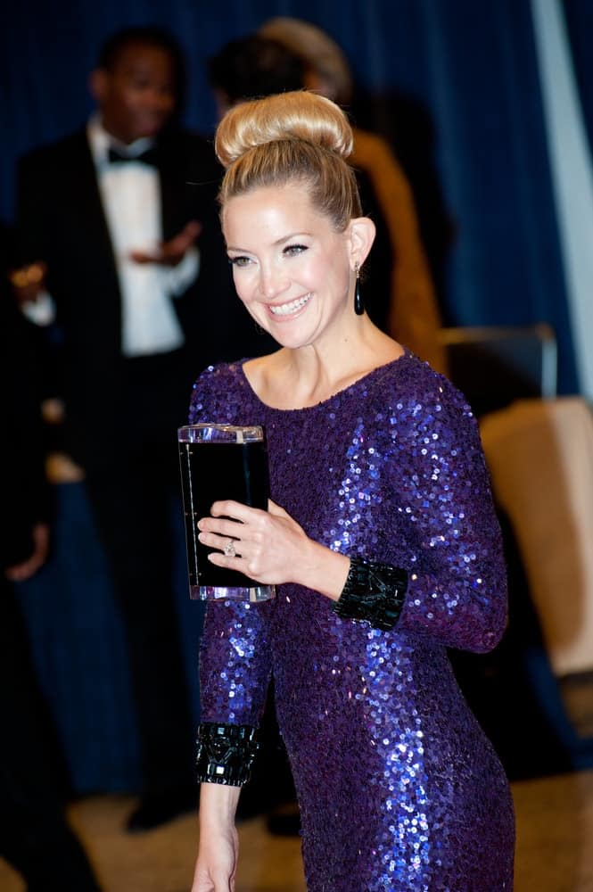 Kate Hudson attended the White House Correspondents Dinner on April 28, 2012, in Washington, D.C. She was quite elegant in her sequined dress and neat top knot bun hairstyle with a slight beehive finish.