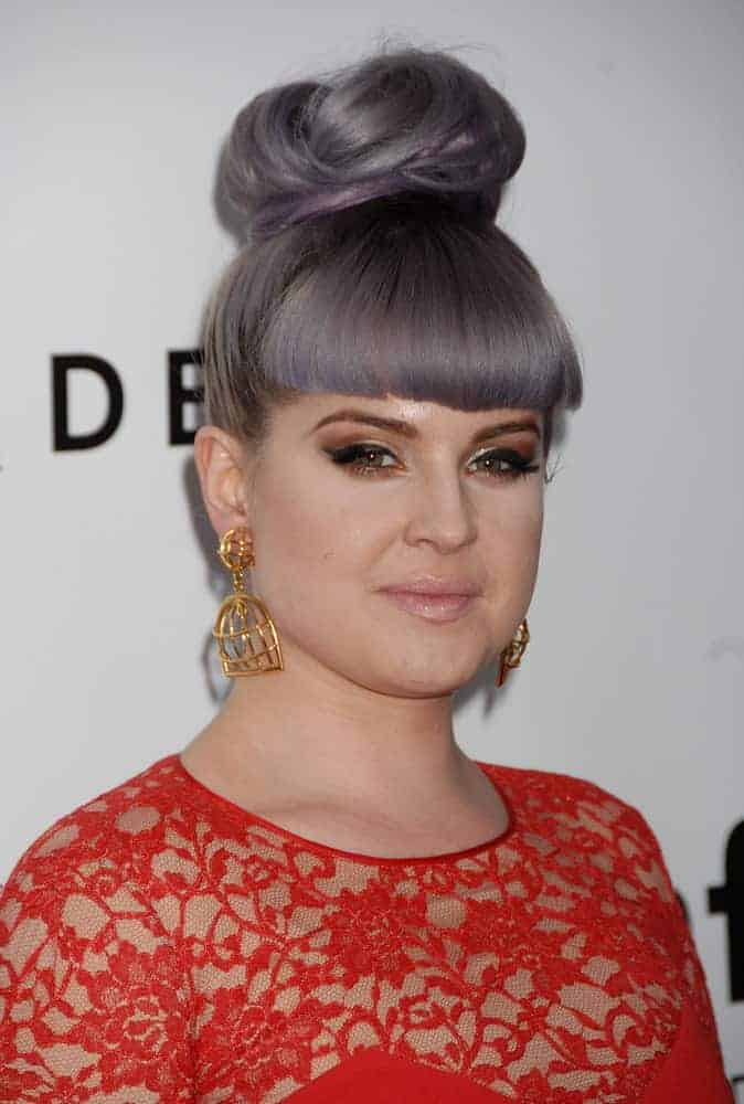 Kelly Osbourne seen wearing an elegant red dress along with her always staggering hairstyle. Photo was taken at the 4th Annual amfAR Inspiration Gala in Los Angeles, California on December 12, 2013.